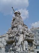 picture of continent  - An angel on the top of the fountain of the four continents with some pigeonsin Trieste in northern Italy - JPG