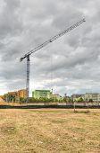 stock photo of construction crane  - Construction site with crane - JPG