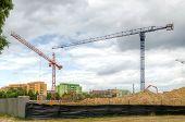 foto of construction crane  - Construction site with cranes - JPG