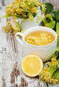 picture of linden-tree  - Cup of herbal tea with linden flowers on a old wooden background - JPG
