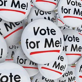 stock photo of election  - Vote for Me buttons or pins for an election candidate campaigning for voter support to win a public office or position - JPG