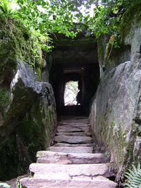 stock photo of step-up  - stone steps leading through a tunnel carved from solid rock in the grounds of blarney castle ireland - JPG