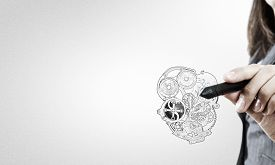 picture of mechanical drawing  - Close up of female hand drawing mechanical heart - JPG