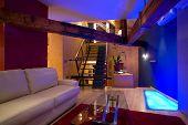 modern living room with blue floor lights