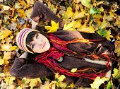 Girl in autumn yellow leaves. Outdoor.