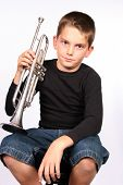 Boy posing with trumpet