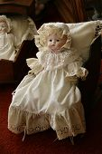 picture of oddities  - Victorian Antique Doll in Old Fashioned Dress - JPG