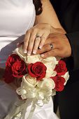 Wedding Rings atop the Bridal Boquet
