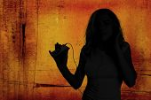 Grunge Image of Beautiful Woman Listening to an MP3 Music Player