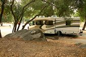 image of motor coach  - Class A RV Coach Parked in a Rural Campsite - JPG