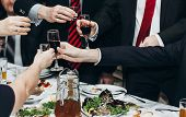 Corporate Business Man Toasting At Dinner Party Table Hands Close-up, Wedding Reception Guests Toast poster