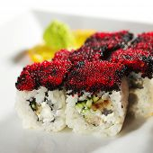 Night City Maki Sushi - Roll made of Cream Cheese, Tamago (japanese omelet), Cucumber and Smoked Eel inside. Tobiko (flying fish roe) outside