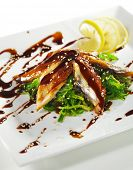 Japanese Cuisine - Chuka Seaweed and Unagi (smoked eel) Salad with Nuts Sauce. Topped with Eel Sauce