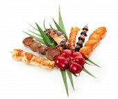 foto of gourmet food  - Grilled Foods Garnished with Green Leaves and Paprika - JPG