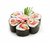 Seafood Maki Sushi - Roll made of Tuna,  Salmon, Scallop and Tobiko (flying fish roe) inside. Garnis