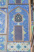 Tiled oriental ornaments mosque's wall and windows on Sheikh Lotfollah mosque on  Naqsh-i Jahan Squa