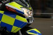 Speeding Police Motorbike With Blurred Background