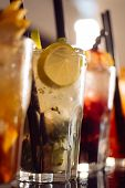 Afterwork Drinks. Alcoholic Mixed Drinks With Ice. Juicy Beverages With Alcohol On Counter. Alcohol  poster