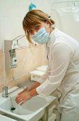 Worker Washing Her Hands