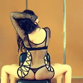 image of stripper shoes  - Stripper on chair - JPG