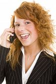 Young redheaded woman using a cell phone