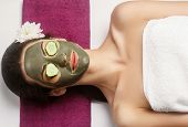 Spa Clay Mask. Woman With Clay Facial Mask And Cucumbers On Eyes In Beauty Spa. Skincare. Beauty Con poster