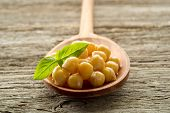 chickpeas with basil over spoon