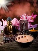 buddha with candle and incense with blur effect