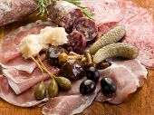italian appetizer with salami, grana,speck,mushroom,cucumber and olives
