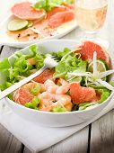 shrimp salad with slice grapefruit and lettuce