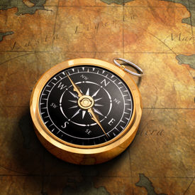 foto of treasure map  - An old fashioned brass compass on a Treasure map background - JPG