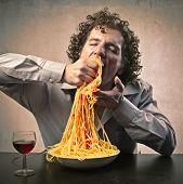 Man gorging of pasta