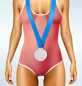 Part of beautiful woman body wearing sports medal