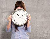 Woman Holding Clock Winking, Indoor