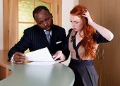 Negotiations Between Red-haired Girl And Black American Man