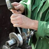 foto of slag  - Welding slag removing with hammer and cutter after welding - JPG