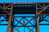 foto of trestle bridge  - Part of a high railroad trestle almost directly overhead - JPG