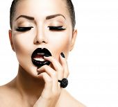 Beauty Vogue Style Fashion Model Girl with Long Lushes, Black Manicure and Lipstick.  Fashion Trendy