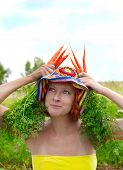 image of oddities  - young eccentric woman with fresh red carrot - JPG