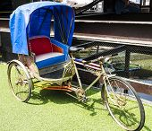 stock photo of rickshaw  - Antique blue rickshaw also called
