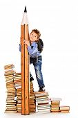 A boy climbing the stairs of books with a huge pencil. Education. Isolated over white.
