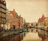 The Singel is one of the numerous canals in Amsterdam, Netherlands . In the background Munttoren . P