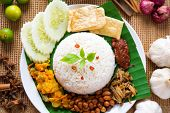 stock photo of malaysian food  - Nasi lemak traditional malaysian spicy rice dish - JPG