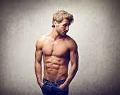 foto of pectorals  - handsome man with muscular physique - JPG