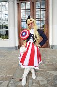 MOSCOW - SEPTEMBER 8: Woman dressed as Captain America at festival Everycon near House of Culture in