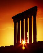 Old columns over sunset, Jupiter's temple of Baalbek, Lebanon, ancient city ruins,historical roman a
