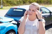 Female Driver Making Phone Calls After Traffic Accident