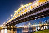 Night scenery of famous attraction landmark, MacArthur bridge, over river in Taipei, Taiwan, Asia.