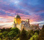 Fairy Palace against sunset sky /  Panorama of Pena National Palace in Sintra, Portugal / Europe