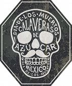 foto of sugar skulls  - the Mexican sugar skull with the hand - JPG